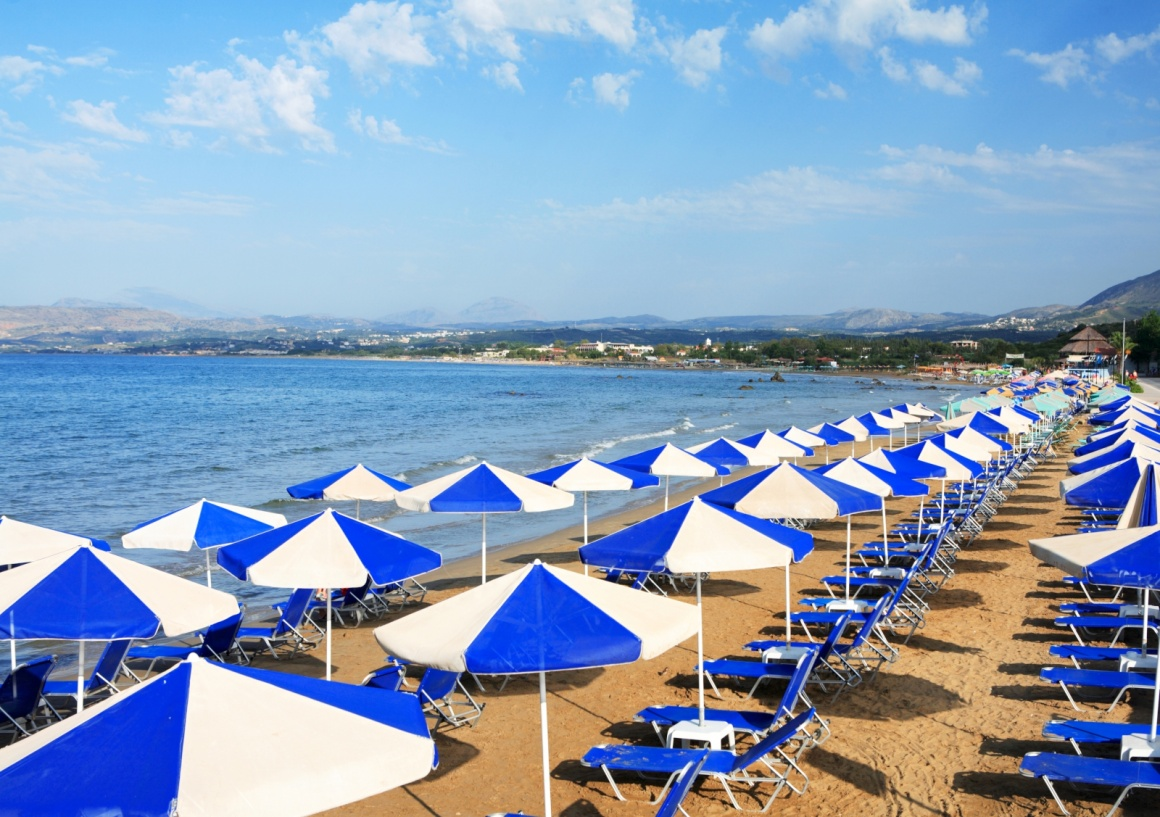 'A view of sunbeds awaiting tourists at the Greek island resort of Georgioupolis on Crete's north coast.' - La Canée